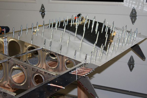 Section 16 - Top wing skin is clecoed in place to prepare for match drilling and dimpling