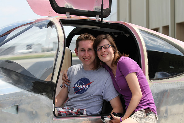 Brian and Brandi Unrein sitting in their RV-10